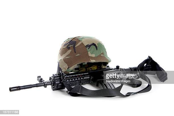Helmet and rifle