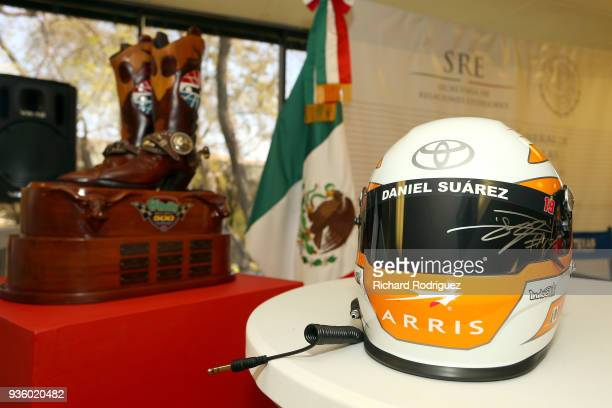 A helmet autographed by Daniel Suarez driver of the ARRIS Toyota that was presented to Francisco de la Torre Galindo Consul General of Mexico in...