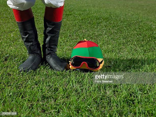 Helmet Besides Jockey's Feet