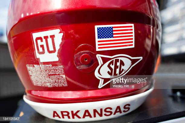 A helmet displays the GU in honor of Garrick Uekman of the Arkansas Razorbacks who passed away this week during a game against the LSU Tigers at...