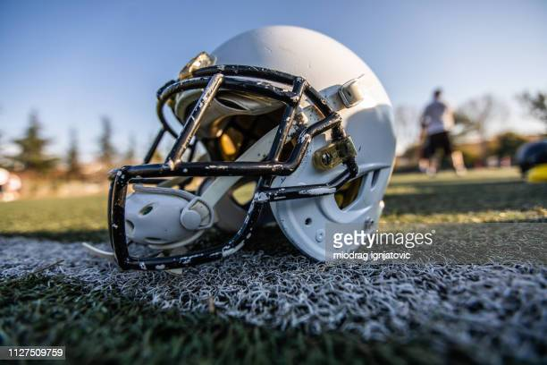 helmet for american football - football helmet stock pictures, royalty-free photos & images