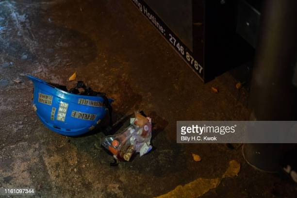 Helmet is seen sitting on the ground after a protester was shot in the eye reportedly by riot police at a demonstration in the Tsim Sha Tsui area on...