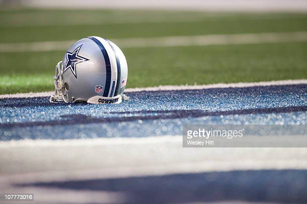 Helmet of the Dallas Cowboys sits on the field before a game against the Washington Redskins at Cowboys Stadium on December 19, 2010 in Arlington,...