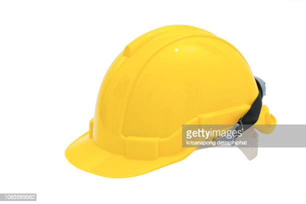 helmet on white background - yellow hat stock pictures, royalty-free photos & images