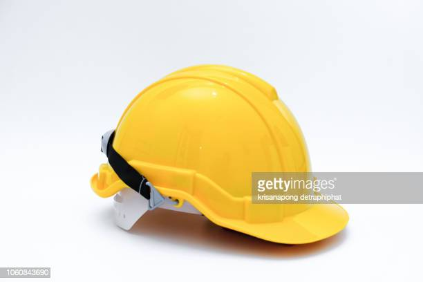 helmet, white background - yellow hat stock pictures, royalty-free photos & images