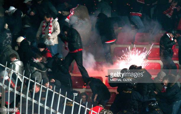 Helmeted antiriot policemen clash with Spartak Moscow's fans during an UEFA Cup Group E soccer match Sparta Prague vs Spartak Moscow in Axa Arena 29...