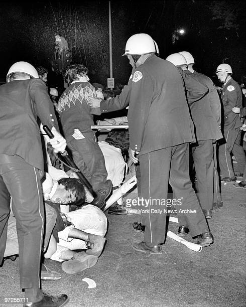 Helmeted Chicago cops flail into crowd of antiwar rioters outsdie Democratic Hilton Hotel headquarters sending many to the ground