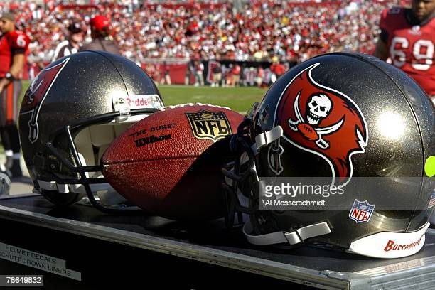 Helmets and an NFL football set behind the bench as the Tampa Bay Buccaneers host the Atlanta Falcons at the Raymond James Stadium on December 16...
