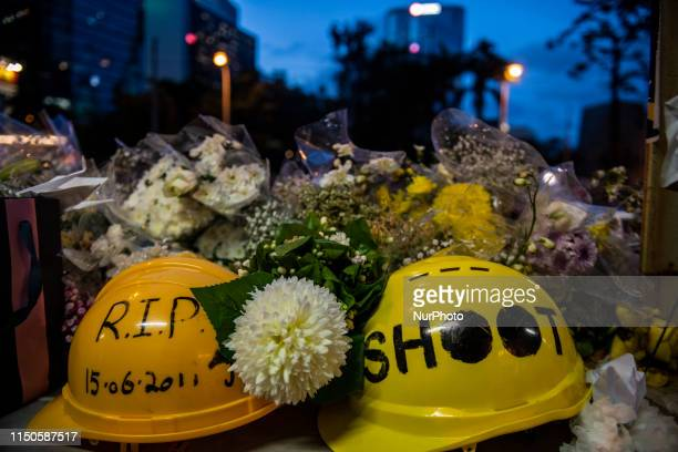 Helmets and Flower are seen place in Honor of a man who died after falling from a scaffolding in Pacific Place while protesting demanding the...