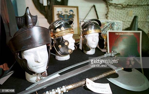 Helmets and swords worn by extras in the recent film 'Gladiator' are displayed 12 December 2000 during a preview of 'Hollywood A Collector's Ransom...