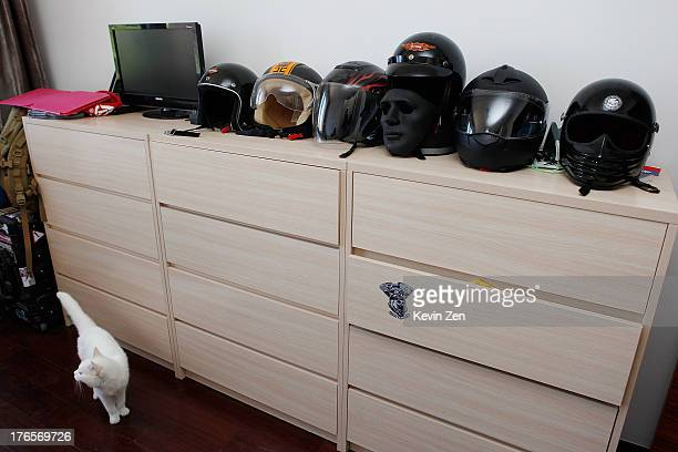 Helmets are lined up in bedroom of Yuan Fei's home founder of new HarleyDavison club called Free Spirit on July 5 2013 in Beijing China More and more...