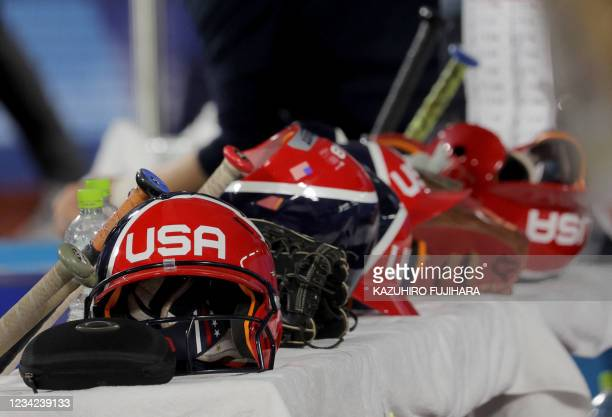 Helmets are placed at the bench prior to the Tokyo 2020 Olympic Games softball gold medal game between Japan and USA at the Yokohama Baseball Stadium...