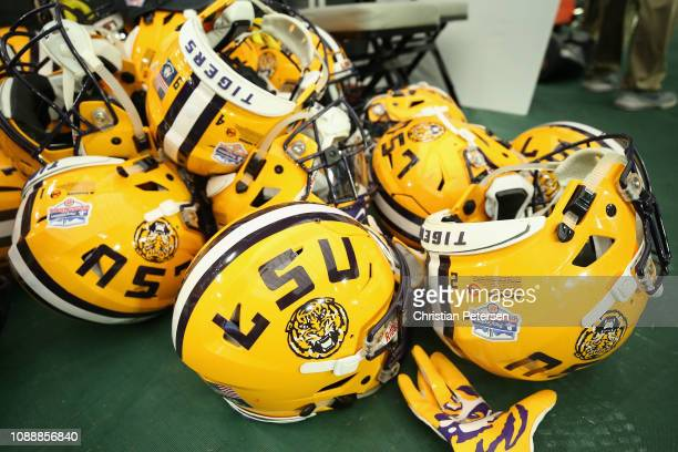 Helmets for the LSU Tigers on the field following the PlayStation Fiesta Bowl against the UCF Knights at State Farm Stadium on January 01 2019 in...