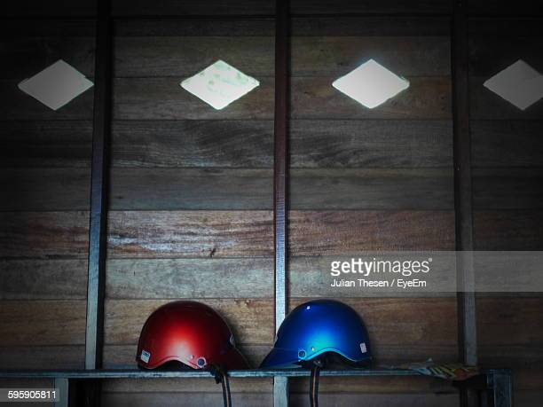 Helmets On Table Against Wooden Wall At Cottage
