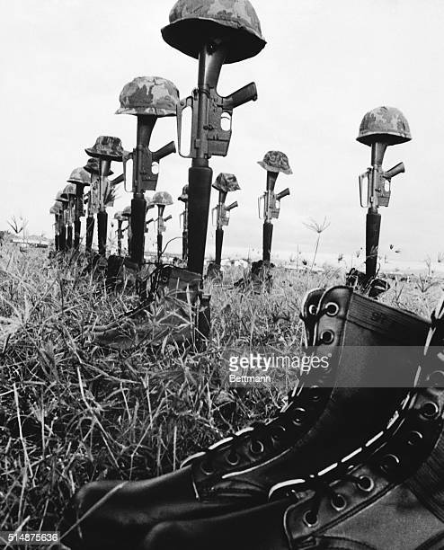 Helmets rifles and jungle boots tell a grim tale of the action fought by the 1st Brigade 101st airborne paratroopers in Operation Wheeler near Chu...