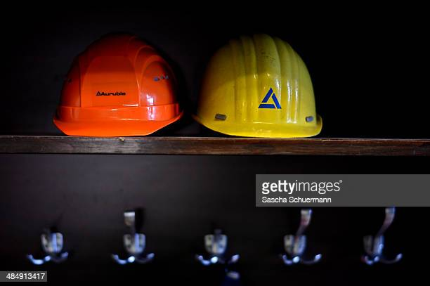 Helmets sit on a shelf at Aurubis AG on February 7 2014 in Luenen Germany Aurubis is Germany's biggest recycler of scrap electronics and extracts...