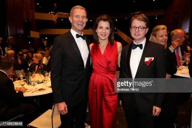 Helmut Andreas Hartwig Anja Broeker and Florian Reuther attend the 8th Opera Gala Bonn for the benefit of the German AIDS Foundation at Opera Bonn on...