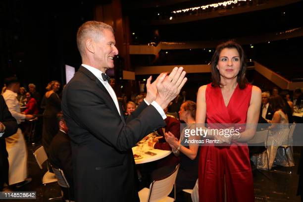 Helmut Andreas Hartwig applauses for Anja Broeker during the 8th Opera Gala Bonn for the benefit of the German AIDS Foundation at Opera Bonn on May...