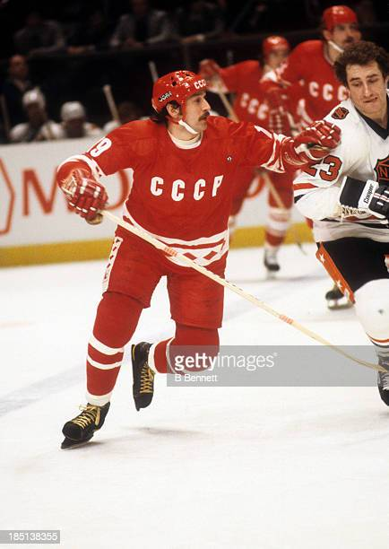 Helmut Balderis of the USSR is defended by Bob Gainey of the NHL AllStars and Montreal Candiens during Game 3 of the 1979 Challange Cup on February...