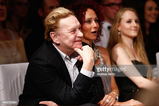Helmut Berger and Christina aka Mausi Lugner attend the GarconF fashion show at Balloni-Hallen on August 5, 2014 in Cologne, Germany.