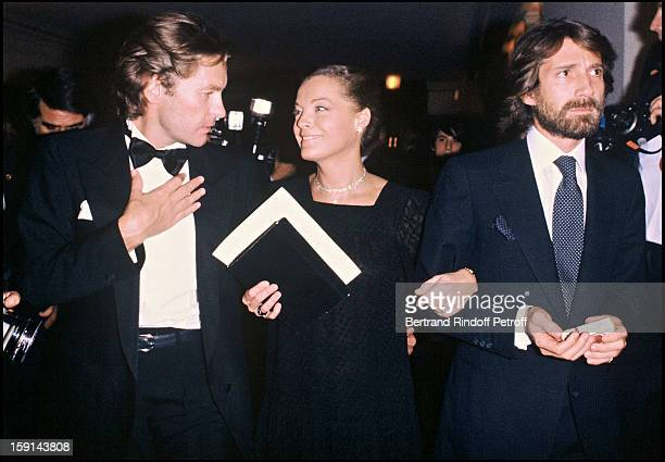 Helmut Berger, Romy Schneider and her husband Daniel Biasini attend a reception honoring Luchino Visconti at the Paris Opera De Paris in 1980.
