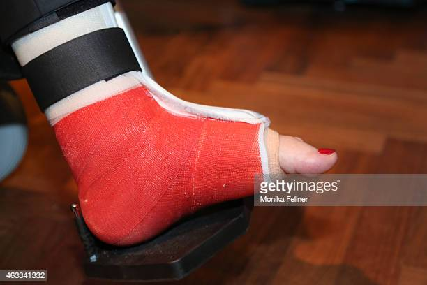 Helmut Berger shows his injured foot at the Champagne And Oyster Reception in Hotel Le Meridien on February 12 2015 in Vienna Austria