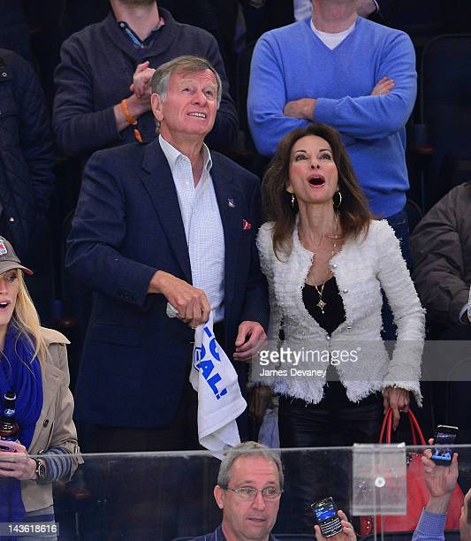 Helmut Huber and Susan Lucci attend the Washington Capitals vs New York Rangers playoff game at Madison Square Garden on April 30 2012 in New York...