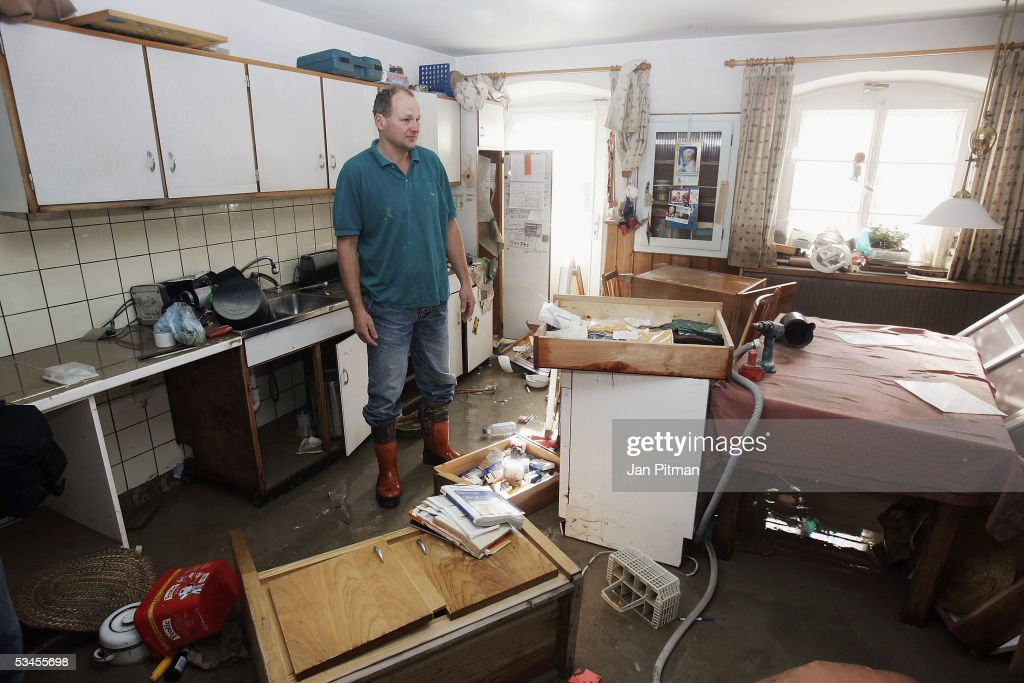 Helmut Koelbl stands in his flood damaged kitchen on August 24, 2005 in Eschenlohe, Germany. People in southern Bavaria are cleaning up the streets and their houses now the water levels in the rivers are dropping. Southern Bavaria was hit with the worst flooding in five-years leaving several towns isolated from the outside world.