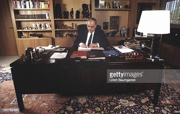 Helmut KOHL CDU Federal Chancellor sitting at his desk in the office of the Federal Chancellery