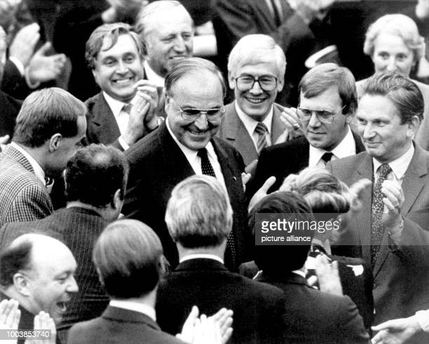 ARCHIVE Helmut Kohl chairman of the CDU receives felicitations from his party friends before the voting results are made public for the chancellor...
