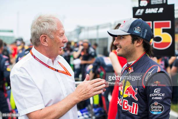 Helmut Marco and Carlos Sainz of Scuderia Toro Rosso and Spain during the Canadian Formula One Grand Prix at Circuit Gilles Villeneuve on June 11...