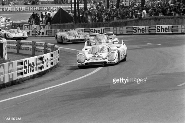 Helmut Marko and Gijs van Lennep pull into the lead in their Porsche 917, at Tertre Rouge during the 24 hour race at Le Mans on 13th June 1971. -...