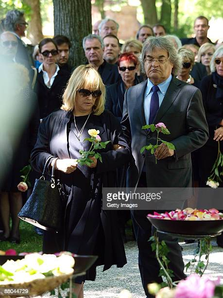 Helmut Markwort and his partner Patricia Riekel attend the funeral of German actress Barbara Rudnik at Nordfriedhof cemetery on May 29 2009 in Munich...