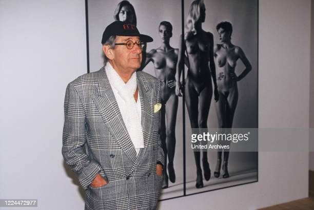 Helmut Newton, German-Australian photographer, in front of one of his pictures at one of his exhibitions, Germany circa 1998.