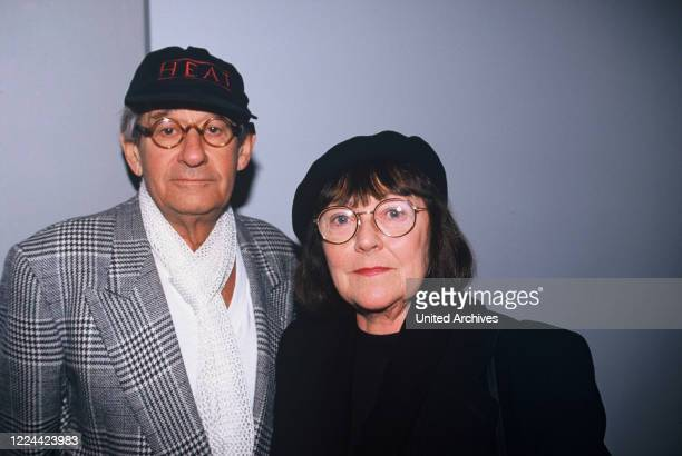 Helmut Newton GermanAustralian photographer with his wife June at one of his exhibitions Germany circa 1998