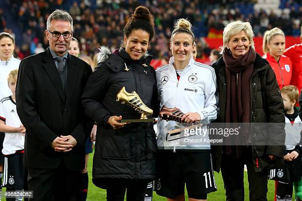 Helmut Sanrock DFB general secretary and head coach Silvia neid of Germany honoured Celia Sasic with the golden boot of the Women's World Cup in...
