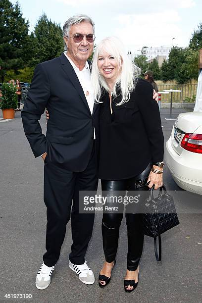 Helmut Schlotterer and wife Ute attend the Marc Cain show during the MercedesBenz Fashion Week Spring/Summer 2015 at Erika Hess Eisstadion on July 10...