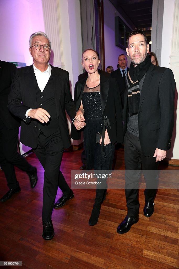Helmut Schlotterer, Founder and CEO of Marc Cain and Kate Bosworth, wearing a dress by Marc Cain, and her husband Michael Polish during the Marc Cain fashion show fall/winter 2017 'Ballet magnifique' at 'Telekom Representation' on January 17, 2017 in Berlin, Germany.