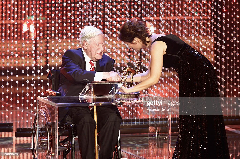 Helmut Schmidt receives the award from Sandra Maischberger during the Bambi Award 2011 show at the Rhein-Main-Hallen on November 10, 2011 in Wiesbaden, Germany.