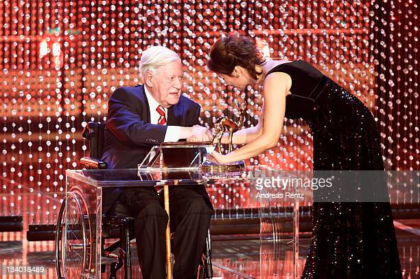 Helmut Schmidt receives the award from Sandra Maischberger during the Bambi Award 2011 show at the RheinMainHallen on November 10 2011 in Wiesbaden...