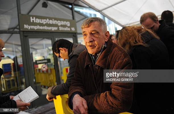 Helmut Sieber a 68yearold pensioner queue up for one of the public seats at the main entrance of the Regional Court in Munich southern Germany on May...