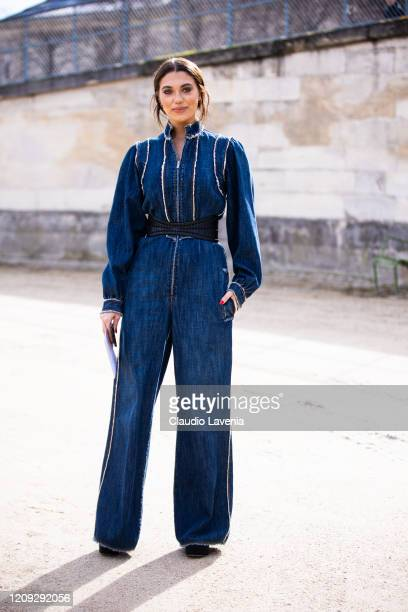 Heloise Agostinelli wearing a denim jumpsuit is seen outside Dior during Paris Fashion Week Womenswear Fall/Winter 2020/2021 Day Two on February 25...