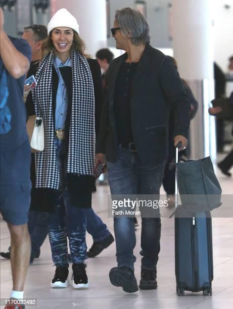 Heloise Pratt and Jon Stevens are seen departing Perth Airport on August 25 2019 in Perth Australia