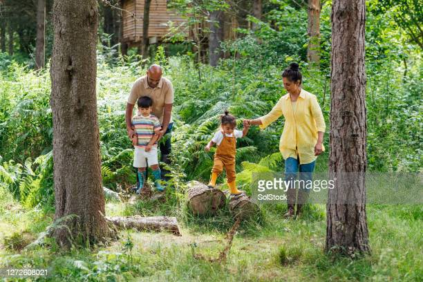 help from grandma and grandad - outdoor pursuit stock pictures, royalty-free photos & images