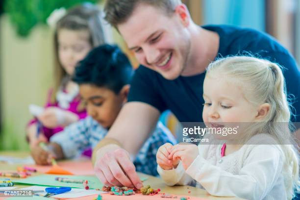 help from teacher - preschool stock pictures, royalty-free photos & images