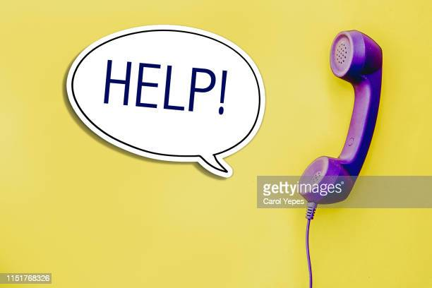 help message in bubble speech from a hand phone - help single word stock pictures, royalty-free photos & images
