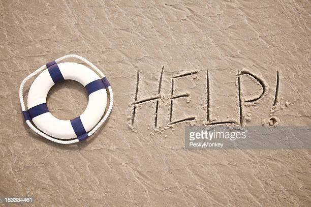 Help Message Written in Sand with Lifesaver