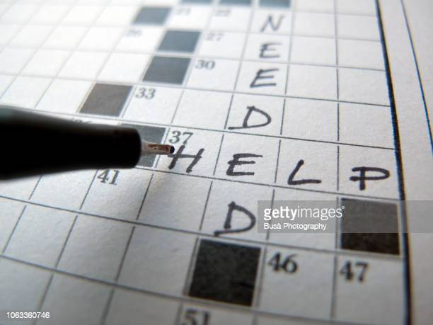 """Help needed"" writing on crossword puzzle"