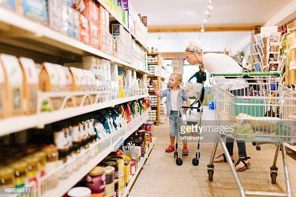help shopping - convenience store interior stock photos and pictures