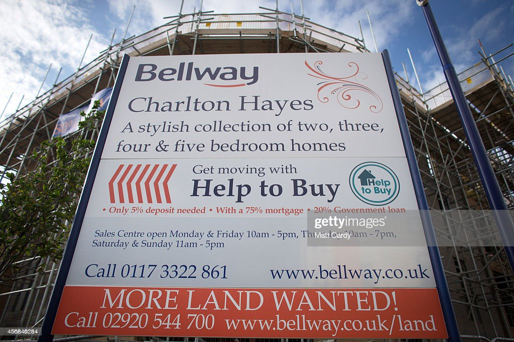 A Help to Buy sign is seen outside a new housing development on October 8, 2014 in Bristol, England. On the first anniversary of the introduction of second phase of the Help to Buy scheme, which provides a government partial guarantee on high loan-to-value mortgages, a new survey from the The Centre for Economics and Business Research (CEBR) claims that house prices in 2015 are set for their first decline since 2011.